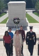 Wachter Middle School students stand with Arlington National Cemetery guard.