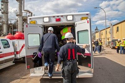 The emergency response team loading up the ambulance.