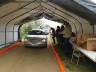 car in tent